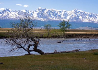 View to the mountain ridge and river in Altai