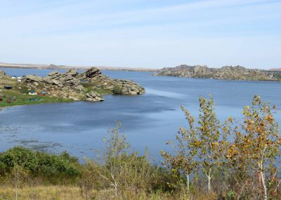 View to the Kolyvan lake with granite rocks